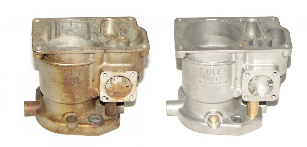 two carburetor bodies, one dirty, one clean Solex 40P-I
